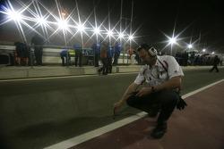 A Bridgestone Tyre engineer checks the track temperature