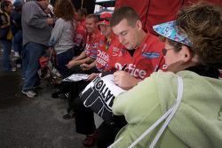 Stewart-Haas Racing Chevrolet crew members sign autographs