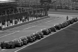 Cars aligned on pit road ready for the practice session
