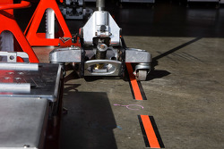 A car jack waits in the garage area