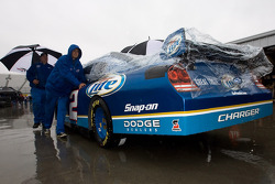 The Miller Lite crew push the car back to the garage as qualifying is rained out