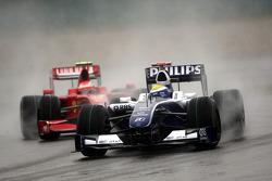 Nico Rosberg, Williams F1 Team leads Kimi Raikkonen, Scuderia Ferrari