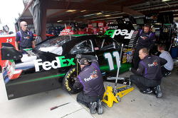 The Fed Ex crew makes adjustments to the car