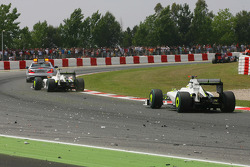 Rubens Barrichello, Brawn GP and Jenson Button, Brawn GP passing the track with spare parts from the crash