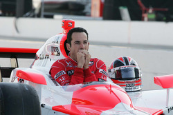 Helio Castroneves, Team Penske tries to stay warm during the front row photo shoot