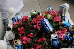 Beer cans among the flower décor