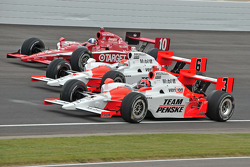 Helio Castroneves, Ryan Briscoe and Dario Franchitti make their way around turn three before the start