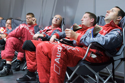 Audi Sport team members take a nap between pit stops