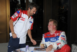 Ford Fiesta driver Andreas Eriksson signs an autograph for a fan