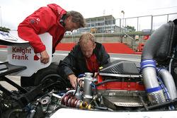 Engineers check a Formula 2 Audi engine