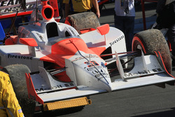 The car of Helio Castroneves, Team Penske is brought back to the garage