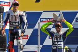 Podium: race winner Valentino Rossi, Fiat Yamaha Team with his donkey hat, and second place Jorge Lorenzo, Fiat Yamaha Team