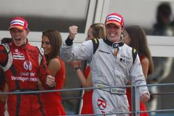 Luiz Razia celebrates his win whilst Nico Hulkenberg celebrates winning the 2009 GP2 Series championship