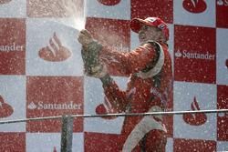 Nico Hulkenberg celebrates winning the 2009 GP2 Series championship on the podium