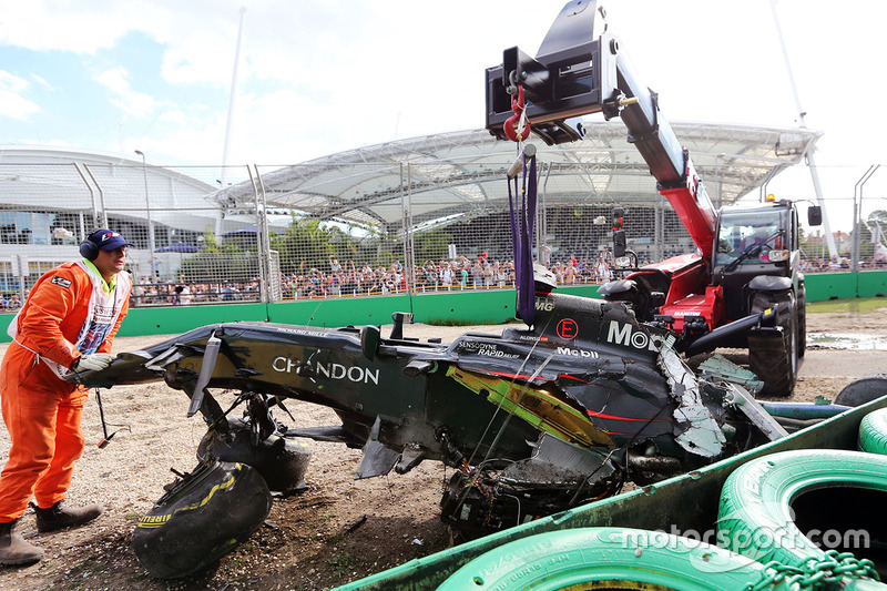 The McLaren MP4-31 of Fernando Alonso, McLaren is removed from the gravel trap after his race stopping crash