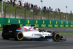 Jenson Button, McLaren MP4-31 and Felipe Massa, Williams FW38 battle for position