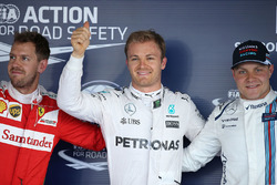 Polesitter Nico Rosberg, Mercedes AMG F1 Team, second place Sebastian Vettel, Ferrari, third place Valtteri Bottas, Williams
