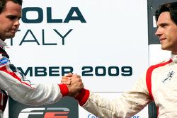 Third placed Milos Pavlovic celebrates on the podium with race winner Andy Soucek