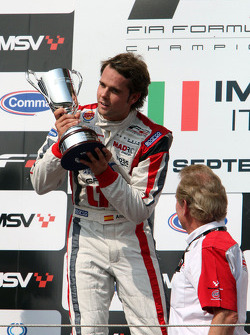 Race winner Andy Soucek celebrates on the podium with Jonathan Palmer Motorsport Vision Chief Executive