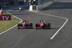 Heikki Kovalainen, McLaren Mercedes and Giancarlo Fisichella, Scuderia Ferrari, exit of the pitlane after the last pitstop