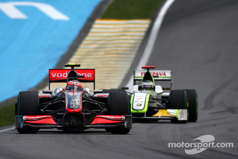 Heikki Kovalainen, McLaren Mercedes lidera a Jenson Button, BrawnGP