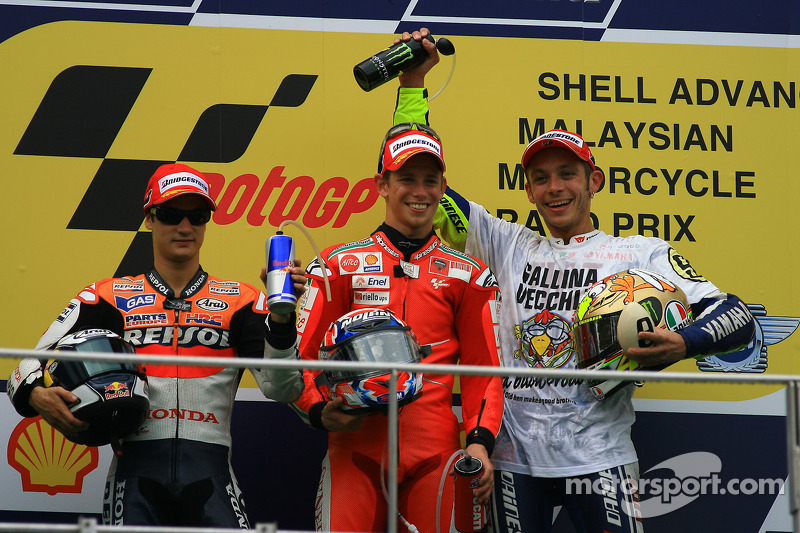 Podio: ganador de la carrera Casey Stoner, Ducati Marlboro Team, el segundo lugar Dani Pedrosa, Reps