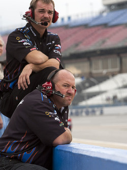 Colin Braun's Conway Freight crew members watch practice action