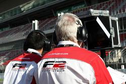 Engineers and mechanics watch the timing screens