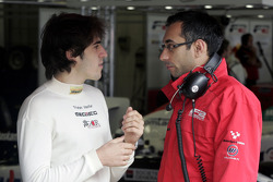 Tristan Vautier talks with an F2 Engineer