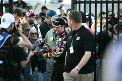 Jeff Gordon signs autographs entering Victory Lane