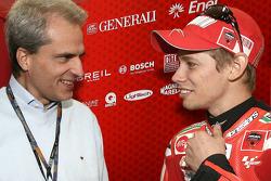 Valencia GP CEO Generali Group Balbinot and Casey Stoner, Ducati Marlboro Team