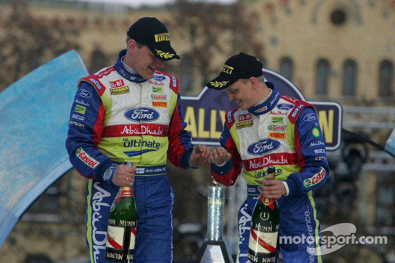 Podium: Mikko Hirvonen en Jarmo Lehtinen, Ford Focus RS WRC08, BP Ford Abu Dhabi World Rally Team