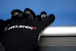 The gloves of a Mclaren mechanic