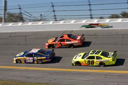 Martin Truex Jr., Michael Waltrip Racing Toyota, Jamie McMurray, Earnhardt Ganassi Racing Chevrolet and Paul Menard, Richard Petty Motorsports Ford