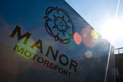 The Manor motorsport truck and logo