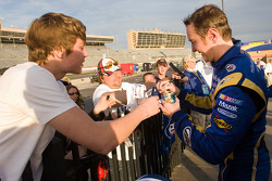 Race winner Kurt Busch, Penske Racing Dodge signs autographs for fans