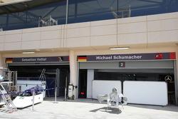 The garages of Sebastian Vettel, Red Bull Racing and Michael Schumacher, Mercedes GP Petronas