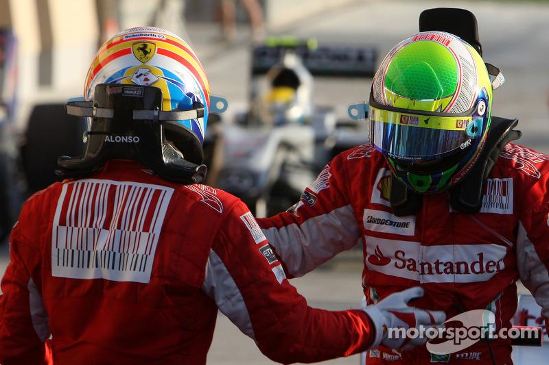 Race winnaar Fernando Alonso, Scuderia Ferrari met 2de Felipe Massa, Scuderia Ferrari