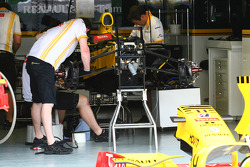 The Renault F1 team work on thier cars