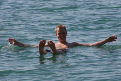 Mikko Hirvonen enjoys the experience of floating in the Dead Sea
