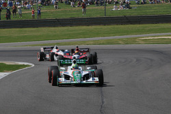 Tony Kanaan, Andretti Autosport leads Justin Wilson, Dreyer and Reinbold Racing and Ryan Briscoe, Team Penske