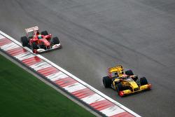 Vitaly Petrov, Renault F1 Team leads Felipe Massa, Scuderia Ferrari
