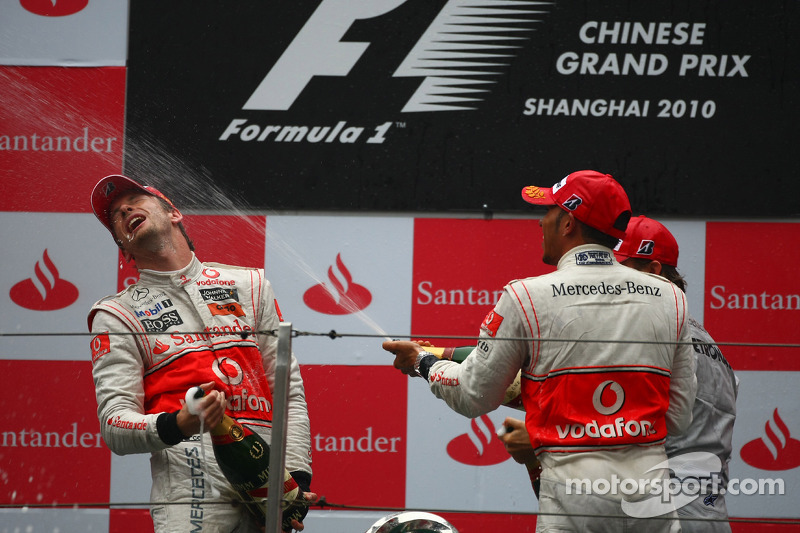 Podium: race winner Jenson Button, McLaren Mercedes, with second place Lewis Hamilton, McLaren Merce