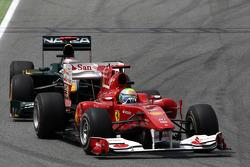 Felipe Massa, Scuderia Ferrari leads Jarno Trulli, Lotus F1 Team
