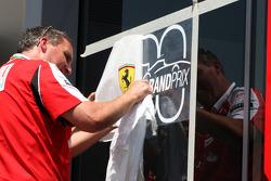 Ferrari put an 800th Grand Prix sticker on their window