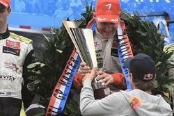 Valtteri Bottas receives the winner's trophy from Sebastian Vettel