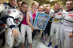 Pole winner Sébastien Bourdais celebrates with teammates Pedro Lamy and Simon Pagenaud, their team a