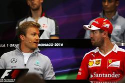 Nico Rosberg, Mercedes AMG F1 and Sebastian Vettel, Ferrari in the FIA Press Conference
