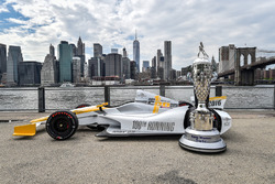 The 100th Indy 500 IndyCar with the BorgWarner Trophy overlooking New York City