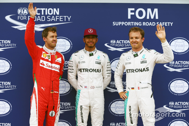 Qualifying top three in parc ferme, Sebastian Vettel, Ferrari, third; Lewis Hamilton, Mercedes AMG F1, pole position; Nico Rosberg, Mercedes AMG F1, second